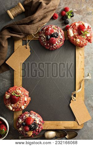 Variety Of Colorful Old Fashioned Fried Gourmet Donuts Around A Chalkboard With Copy Space