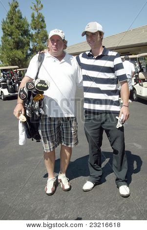 MOORPARK, CA - AUG. 29: Jeremy Sumpter (R) with guest at the 4th annual Scott Medlock-Robby Krieger Concert & Golf Classic on Aug. 29, 2011 at the Moorpark Country Club in Moorpark, California.