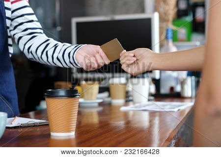 Customer Paying Coffee By Credit, Debit Electronic Card At Cafe Counter, Food And Drink Business Con