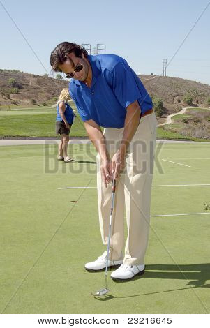 MOORPARK, CA - AUG. 29: Scott Elrod practices at the putting green at the 4th annual Scott Medlock-Robby Krieger Concert & Golf Classic on Aug. 29, 2011 at the Moorpark Country Club in Moorpark, CA.