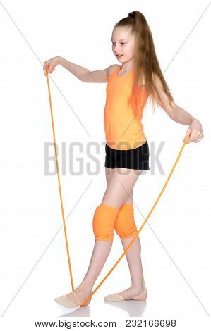 A Girl Gymnast Performs Exercises With A Skipping Rope. The Concept Of A Healthy Lifestyle, Sports E