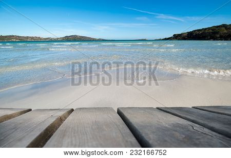 Wooden Board With Beautiful Beach As Background. Copy Space For Your Free Text. Summer Holiday Or Va
