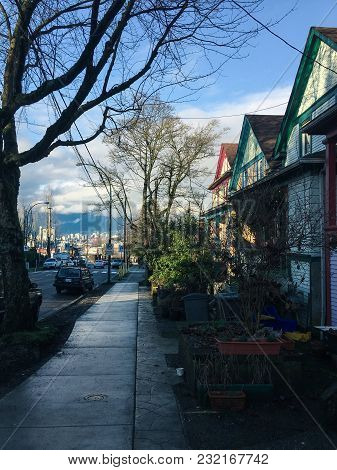 Sunny Day In Winter In An East Vancouver Residential Street Neighborhood With Row Of Old Colorful Ho