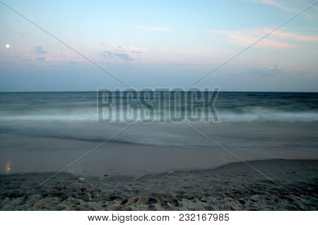Long Exposure Of The Surf Going In And Out Along The Shoreline Of The Atlantic Ocean After Sunset