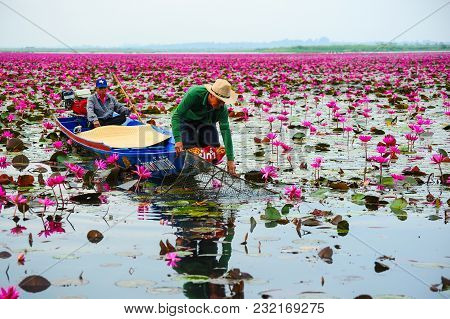 Udon Thani, Thailand - December 8, 2011, Fisherman On Blue Boat Fishing By Using Fishing Wired Baske