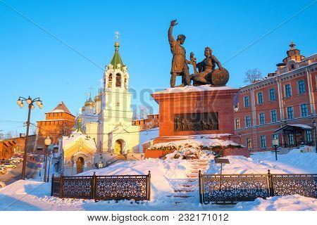 Nizhny Novgorod, Russia - March, 10, 2018: monument of Minin and Podzarsky in Nizhny Novgorod in winter at sunset