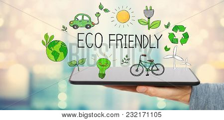 Eco Friendly With Man Holding A Tablet Computer