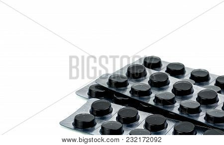 Activated Charcoal Tablets Pills In Blister Pack Isolated On White Background With Copy Space For Te