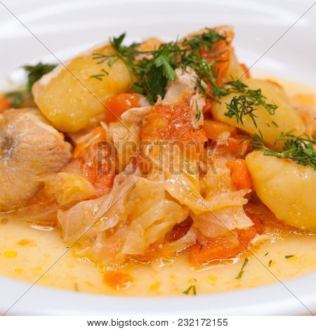 Stewed vegetables in a white bowl