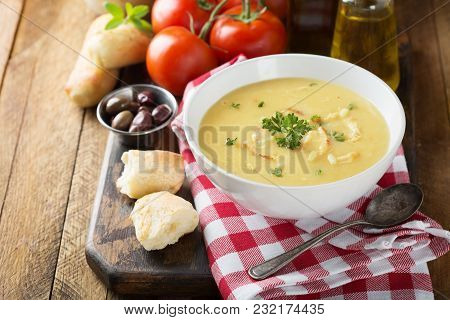 Creamy Lemon Chicken Soup With Rice Garnished With Parsley
