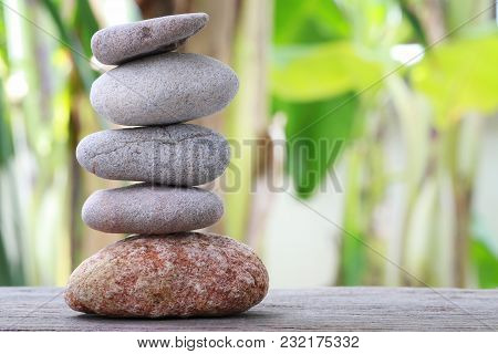 Balance Stones Stacked To Pyramid In The Soft Green Background To Spa Ideas Design Or Freedom And St