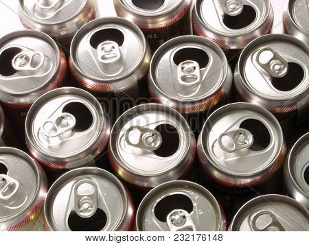 Pile of many empty aluminium drink cans background.
