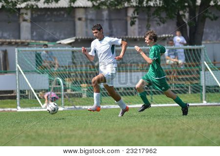 KAPOSVAR, HUNGARY - SEPTEMBER 5: Bence Kovacs (white 6) in action at the Hungarian National Championship under 17 game Kaposvar (white) vs. Nagyatad (green) September 5, 2011 in Kaposvar, Hungary.