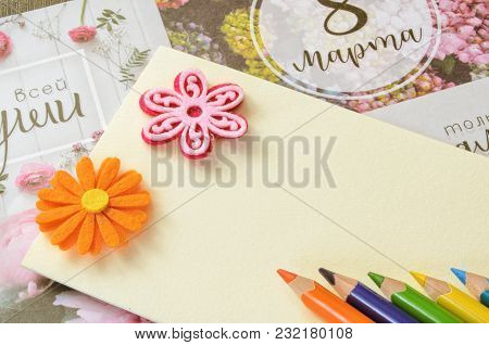 Colored Pencils, Two Stickers For Applique In The Form Of Flowers On A Blank Sheet Of A Cardboard. A