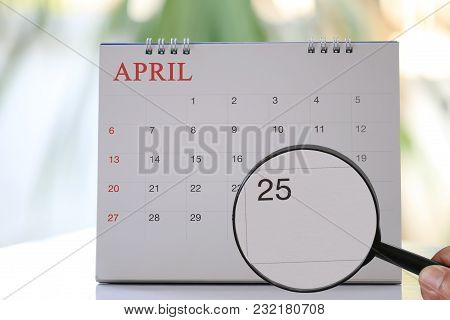 Magnifying Glass In Hand On Calendar You Can Look Twenty Five Day Of Month,focus Number Twenty Five