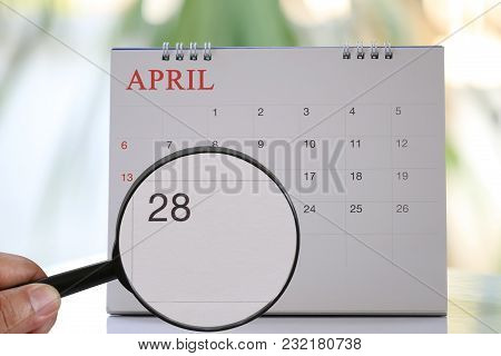 Magnifying Glass In Hand On Calendar You Can Look Twenty-eight Day Of Month,focus Number Twenty-eigh