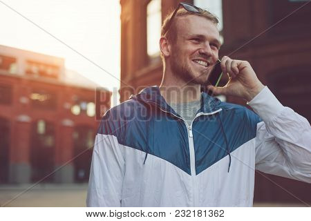 Young Man Speaking On The Mobile Phone On The Street, Outdoors
