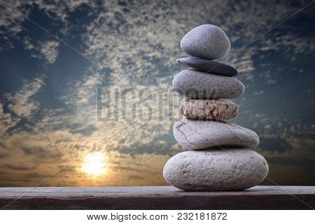 Balance Stones Stacked To Pyramid In The Sunset Sky Background To Spa Ideas Design Or Freedom And St