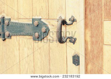 Old Vintage Door Handle. Vintage Iron Handle And Wooden Doors. Wood Doors And Walls Are Different In