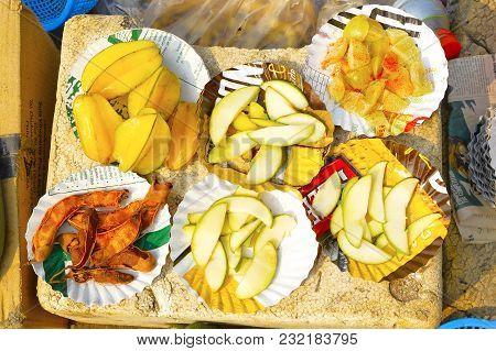 Sliced Konkani Fruit Like Tamarind, Amla Or Indian Gooseberry, Raw Mango And Star Fruit Or Carambola