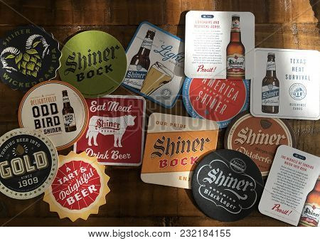 Round Rock, Texas - March 19, 2018: Shiner Bock Coasters. A Group Of Assorted Coasters From The Spoe