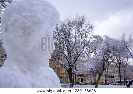 Sculpture of famous poet Alexander Pushkin from snow on  Square of Arts in St. Petersburg, Russia