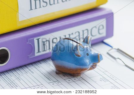 Clean Insurance Form, Folders And Piggy Bank