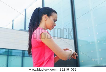 Young and sporty girl with a smartwatch.