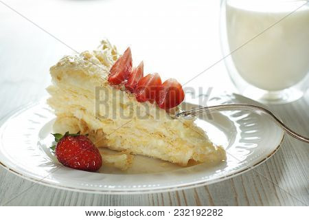 A Piece Of Cake Is Napoleon Made Of Puff Pastry With Cream Cream, Decorated With A Flower Bed, Next