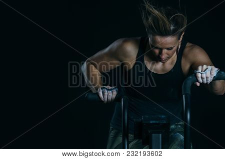 Close Up Of A Front View Of A Young Sporty Woman Doing Calorie Assault Exercise On A Fitness Routine
