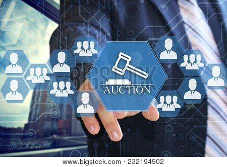 The Businessman Chooses Auctions  Button On The Touch Screen With A Futuristic Background .the Conce