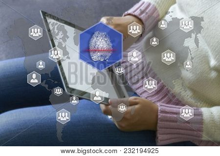 Fingerprint Scanning On The Touch Screen With A Blur The Girl With The Gadget Background .the Concep
