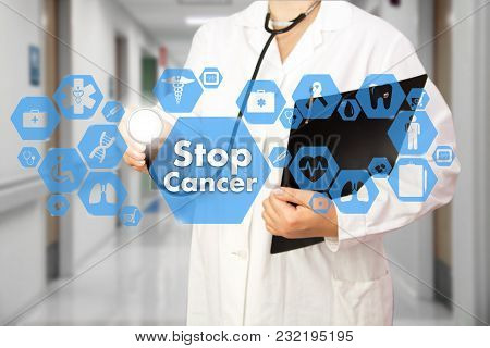 Medical Doctor With Stethoscope And Stop Cancer Sign In Medical Network Connection On The Virtual Sc