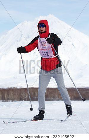 Petropavlovsk City, Kamchatka Peninsula, Russian Far East - Feb 10, 2018: Skier Running Along The Wi