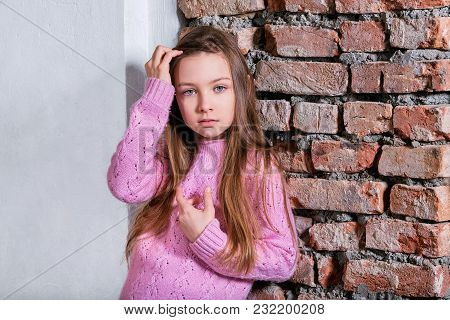 Portrait Fashion Kid Girl.caucasian Child 9 Years In Pink Sweater Posing Near Brick Wall, Loft Inter