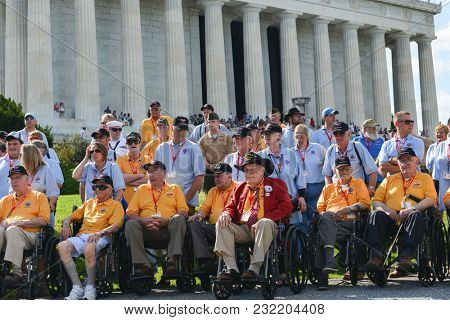 WASHINGTON DC / UNITED STATES - JUNE 08 2014: Elderly veterans visiting Lincoln Memorial and other Monuments via nonprofit organizations during Memorial Weekend