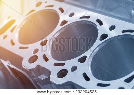 Close-up Of The Cylinder Block In The Light Blue Scene.automotive Part,machine Part .