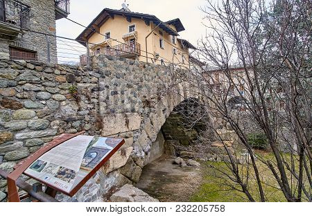 Aosta, Italy - March 9, 2018: A Historic Ancient Bridge On 9 March 2018 In Aosta, Italy. In The City