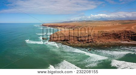 Aerial view on ocean waves and rocks on the Atlantic coast in Morocco
