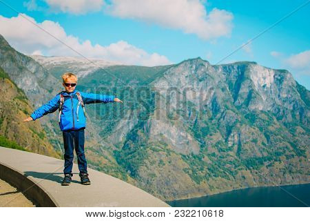 Happy Little Boy Travel In Mountains, Hiking In Nature, Family Vacation