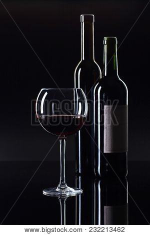 Bottles And Glass Of Red Wine . Old Paper Label . Copy Space .