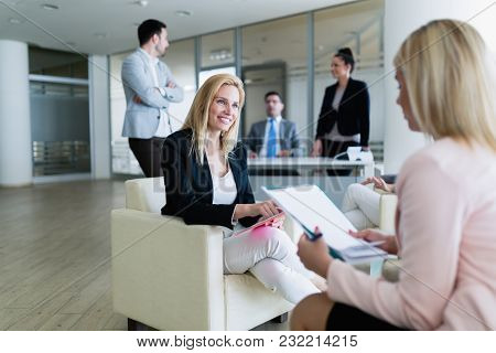 Picture Of Attractive Smiling Saleswoman Working In Office
