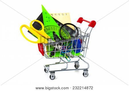 Items For School In A Shopping Cart Isolated On A White Background. Concept Of Buying Items For Scho