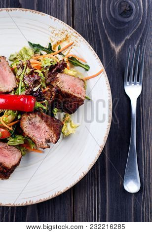 Veal Salad With Lettuce, Carrot, Tomato And Pepper On White Plate On Dark Wooden Background, Copy Sp