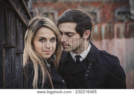 Couple In Love Hugging Kissing Smiling Tenderness. Kiss And Love In Every Look. Art Street Fashion M