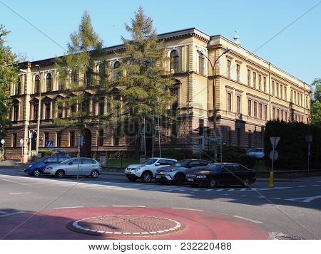 CIESZYN, POLAND EUROPE on October 2017: Second grammar school in polish city center with car on parking place and clear blue sky in warm sunny autumn day.
