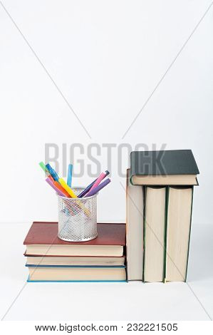 Open Book, Hardback Colorful Books On Wooden Table, White Background. Back To School. Copy Space For