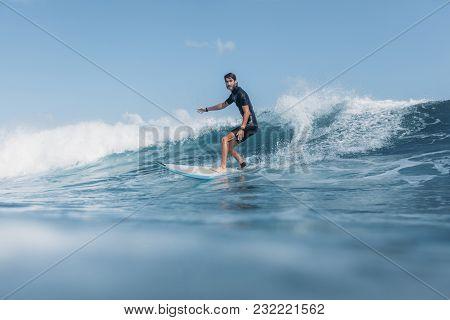 Sports Man Surfing Wave On Surf Board In Ocean