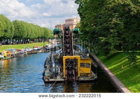 Russia, Saint Petersburg - August 18, 2017: Work To Deepen The Bottom In The Channel Of The Urban Ri