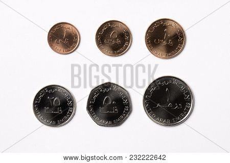 Coins From United Arab Emirates On A White Background
